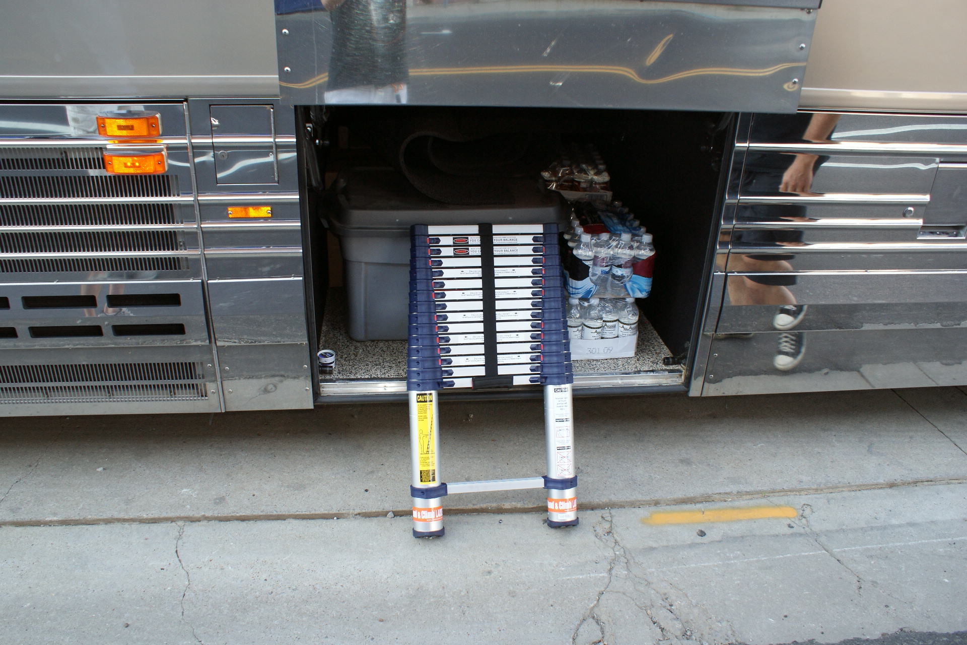 Telescoping ladders easily store in the baggage compartments of this tour bus.